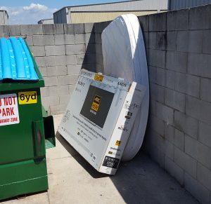 Trash outside of the Dumpster